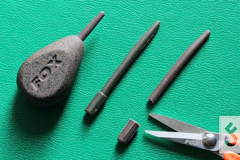 Haal de insert uit het inline lood en knip het dikke deel van de insert af.